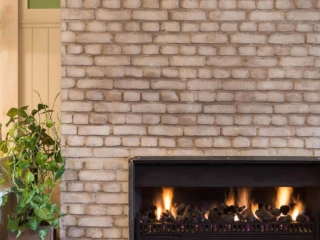 faux white brick wall fireplace - muros
