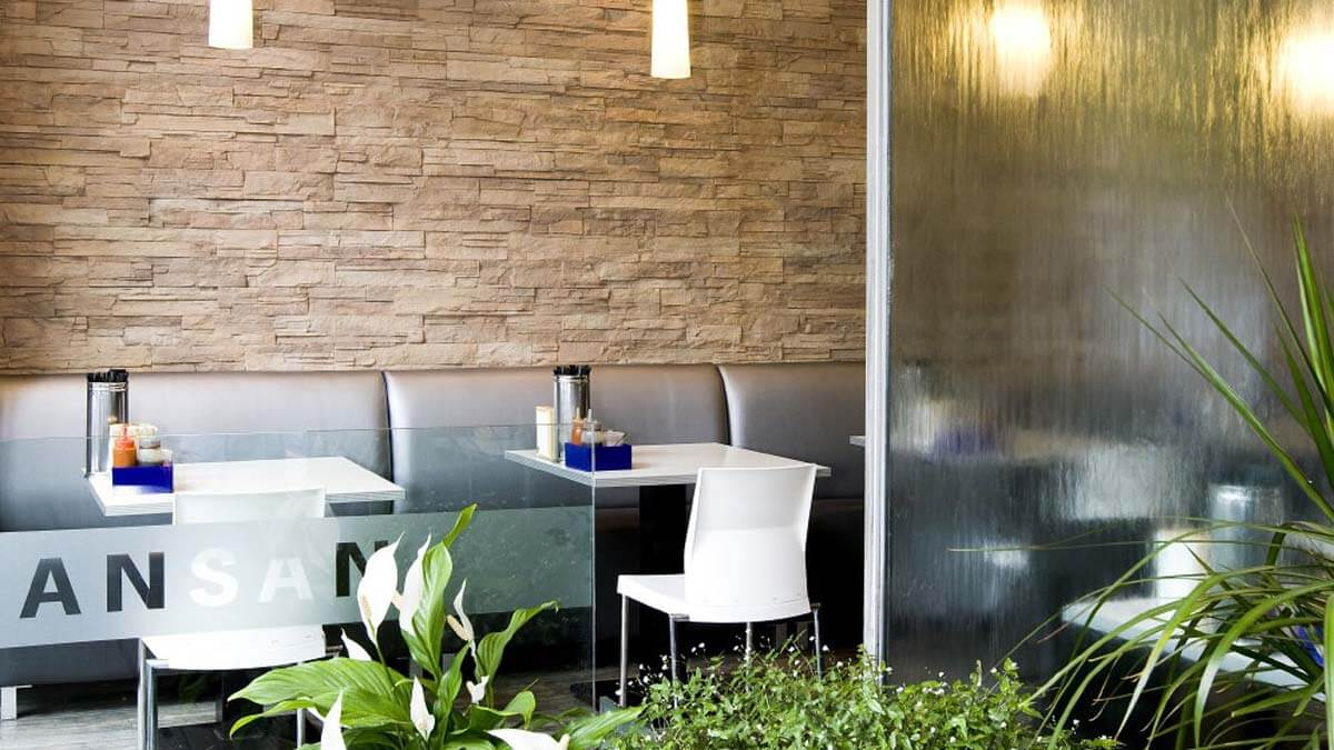 earth strata stone wall cafe - muros